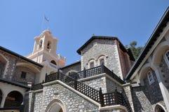 Kykkos monastery and the Greek flag Royalty Free Stock Photography