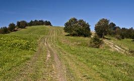 Kykula kulle på Slovakisk-polermedel gränser Arkivbild