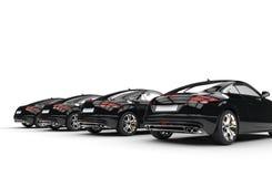 Kyla snabba bilar - svart - den tillbaka sikten Royaltyfria Foton