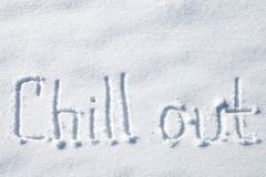 kyla ut Hand dragen text över snö fotografering för bildbyråer