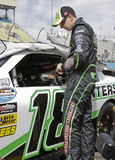 Kyle Busch. NASCAR driver Kyle Busch preparing to enter his Sprint Cup Interstate Batteries race car Royalty Free Stock Images