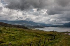 Kyle of Durness under heavy rain clouds, Scotland. Northwest Coast, Scotland - June 6, 2012: Kyle of Durness, part of Atlantic Ocean surrounded by mountains Stock Image
