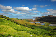 Kyle of Durness view, northern Scotland. A rich saturation, grass and blue sky in this astonish view royalty free stock photo