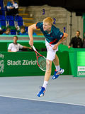 Kyle Edmund at Zurioch Open 2012. ZURICH, SWITZERLAND-MARCH 24: Kyle Edmund plays tennis in final of BNP Paribas Open Champions Tour against Mitchell Krueger in Royalty Free Stock Photos