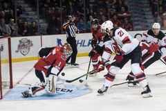 Kyle Palmieri of the New Jersey Devils Shoots. Against Mike Condon of the Ottawa Senators in National Hockey League action. The NHL game was won by the devils Stock Photo