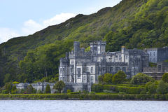 Kylemore Abbey. In Ireland. Focus on facade of structure near middle of frame Stock Images