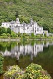 Reflection of Kylemore Abbey, Connemara, west of Ireland. Kylemore Abbey is a Benedictine monastery founded in 1920 on the grounds of Kylemore Castle, in Royalty Free Stock Images