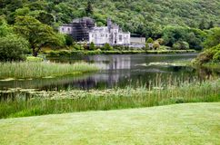 Kylemore Abbey Castle in Connemara County Galway Ireland. CONNEMARA, IRELAND – Jun 16, 2017: Kylemore Abbey is a Benedictine monastery founded in 1920 on royalty free stock photo