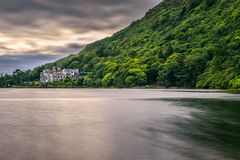 Kylemore Abbey in Ireland and the Pollacapall Lough royalty free stock image