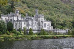Kylemore Abbey Connemara County Galway Ireland. With trees and the lake royalty free stock image