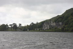 Kylemore Abbey in Connemara, Ireland. Connemara National Park is a vast expanse of mountains, bogs and lakes Royalty Free Stock Photo