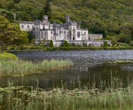 Kylemore abbey in Connemara. With its beautiful lake in the foreground royalty free stock photos