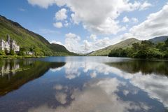 Kylemore Abbey in Connemara mountains and reflections in a beautiful lake, County Galway, Ireland.  stock image