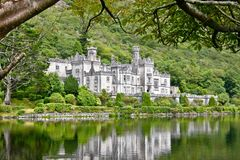 Kylemore Abbey, Connemara, west of Ireland. Kylemore Abbey is a Benedictine monastery founded in 1920 on the grounds of Kylemore Castle, in Connemara, County Stock Photos