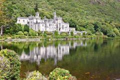 Kylemore Abbey, Connemara, west of Ireland. Kylemore Abbey is a Benedictine monastery founded in 1920 on the grounds of Kylemore Castle, in Connemara, County Royalty Free Stock Photo