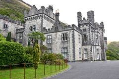 Kylemore Abbey, front entrance, Connemara, west of Ireland. Kylemore Abbey is a Benedictine monastery founded in 1920 on the grounds of Kylemore Castle, in Royalty Free Stock Image