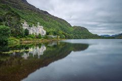 Kylemore Abbey in Ireland with reflections in the Pollacapall Lough stock photography
