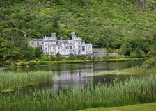 Kylemore Abbey on the lake. National park Connemara in Ireland royalty free stock image
