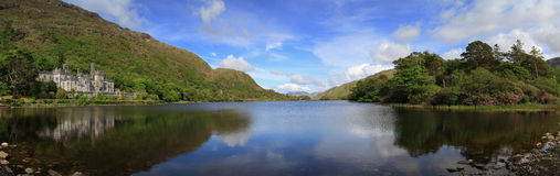 Kylemore Abbey and mountains. Kylemore Abbey in Connemara mountains panoramic - Ireland Royalty Free Stock Photography