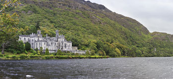 Kylemore Abbey in mountains on the lake. Royalty Free Stock Photos
