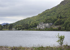 Kylemore Abbey in mountains on the lake. Stock Image