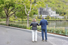 Kylemore Abbey, Pollacappul, Connemara, Co. Galway,  Ireland Jun. E 2017, Tourists looking at the Kylemore Abbey castle while is on works Royalty Free Stock Images