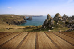 Kynance Cove cliffs looking across bay with wooden planks floor Stock Photo
