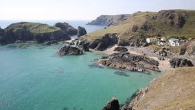 Kynance Cove Cornwall England UK on a beautiful sunny summer day with blue sky and sea stock footage
