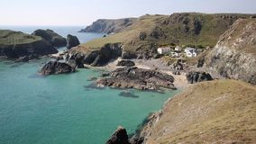 Kynance Cove The Lizard Cornwall England UK on a beautiful sunny summer day with blue sky and sea stock video footage