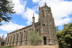 St Paul's Church of England 1856 bluestone building has seven bays and a tower which was added in 1928. KYNETON, AUSTRALIA - February 11, 2018: St Paul royalty free stock image