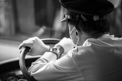Kyoto city bus driver wearing mask at work, Japan Royalty Free Stock Photography