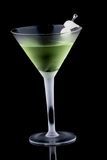 Kyoto cocktail - Most popular cocktails series. Kyoto cocktail in chilled martini glass over black background on reflection surface. Green color, gin, dry Royalty Free Stock Photo