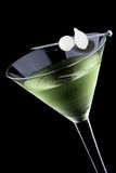 Kyoto cocktail - Most popular cocktails series. Kyoto cocktail in chilled martini glass over black background on reflection surface. Green color, gin, dry stock image