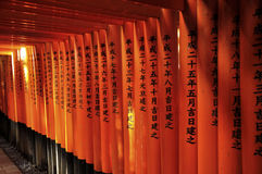 Kyoto fushimi inari written. Fushimi Inari Shrine is an important Shinto shrine in southern Kyoto. It is famous for its thousands of vermilion torii gates, which Stock Photography