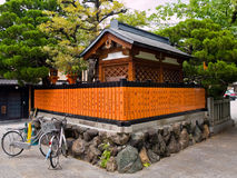 Kyoto Gion Shrine. Small Japanese Shinto shrine, with two bicycles in front of it, in the Gion district of Kyoto, Japan royalty free stock images