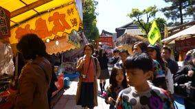 The tourist walking in shopping street near architecture Fushimi Inari Shrine temple stock video footage