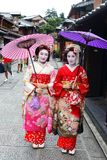 Young Japanese girls dressed in geisha`s custom taking a walk in the stone-paved roads of Ninenzaka and Sannenzaka. Kyoto, Japan-August, 11th of 2017: Young Royalty Free Stock Photography