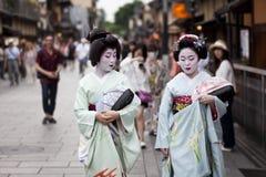 KYOTO,JAPAN- CIRCA MAY, 2016: Maiko geisha walking on a street of Gion in Kyoto Japan Stock Images