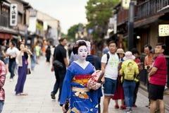 KYOTO,JAPAN- CIRCA MAY, 2016: Maiko geisha walking on a street of Gion in Kyoto Japan Royalty Free Stock Photos