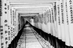 Kyoto, Japan - December 27, 2009: Wooden torii tunnel in Fushimi Inari Taisha Shrine. It is one of the most famous place for stock image