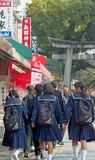 Kyoto, Japan - 2010: Japanese school girls heading towatds Fushimi Inari Taisha Shrin royalty free stock images