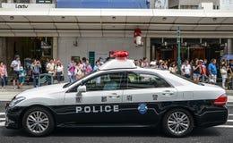 Kyoto, Japan - 24 Juli 2016 Politiewagen bij het Gion Matsuri-festival bij hete de zomerdag in Kyoto stock afbeelding