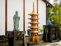 KYOTO, JAPAN - JULY 05, 2017: Beautiful minuature golden structure of Yasaka Pagoda Gion structure with a miniature Royalty Free Stock Photo