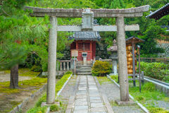 KYOTO, JAPAN - JULY 05, 2017: Beautiful view at park with a stoned door in the path inside of the park in Yasaka Shrine Royalty Free Stock Photos