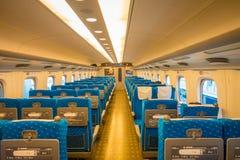 KYOTO, JAPAN - JULY 05, 2017: Indoor view of JR700 shinkansen bullet train departing Kyoto station in Kyoto, Japan.  Royalty Free Stock Image