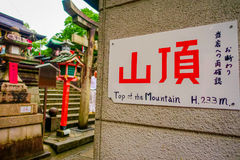 KYOTO, JAPAN - JULY 05, 2017: Informative sign at the to vist the red Tori Gate at Fushimi Inari Shrine in Kyoto, Japan Stock Photography