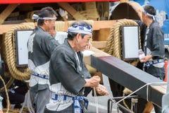 Kyoto, Japan - July 17, 2016: Japanese men in traditional clothing preparing Yamaboko float in Gion Matsuri parade Royalty Free Stock Photography
