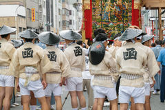 Kyoto, Japan - July 17, 2016: Japanese men in traditional clothing preparing Yamaboko float in Gion Matsuri parade Stock Photo