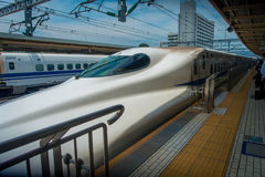 KYOTO, JAPAN - JULY 05, 2017: JR700 shinkansen bullet train departing Kyoto station in Kyoto, Japan.  Stock Photos