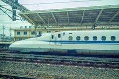 KYOTO, JAPAN - JULY 05, 2017: JR700 shinkansen bullet train departing Kyoto station in Kyoto, Japan.  Royalty Free Stock Photography